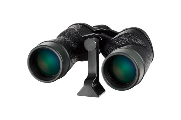 [photo] Binoculars with green lenses sitting on top of tripod adaptor accessory
