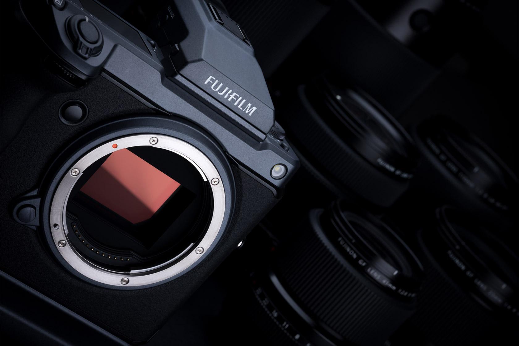 [ph[photo] Fujifilm GFX System digital camera body only next to assorted lenses