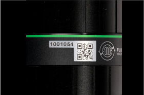 [photo] Close-up view of a barcode and id on a Machine Vision Lens