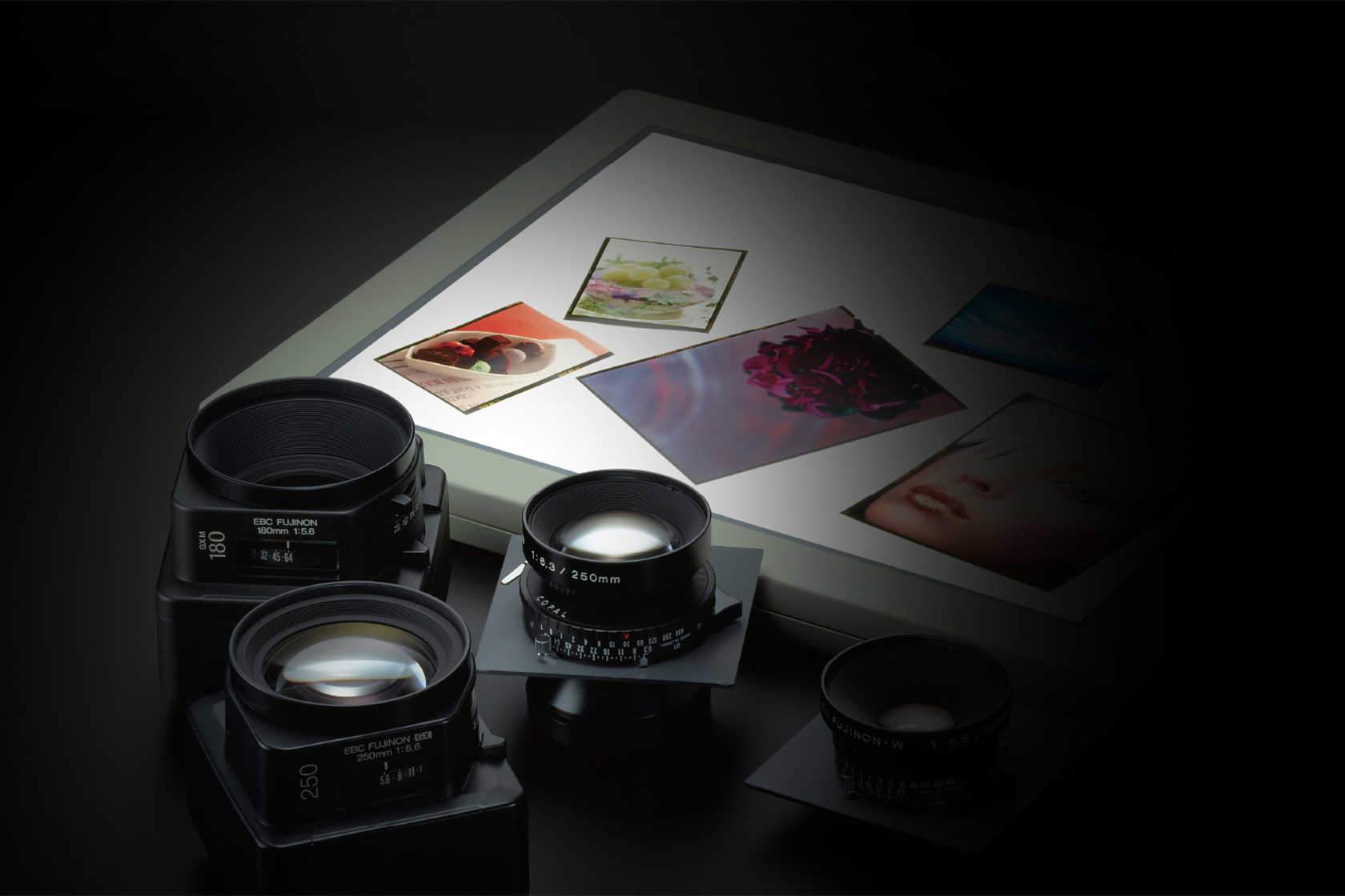 [photo] Assorted Fujifilm GFX Systems lenses with a collage of pictures in a picture frame