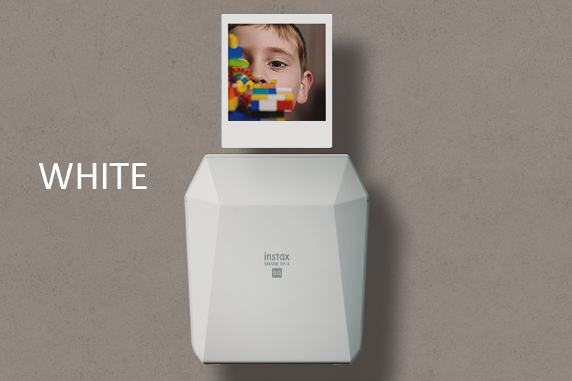 """[photo] Instax SHARE SP-3 in white with a sample print on top and a """"White"""" text in white on a grey background."""