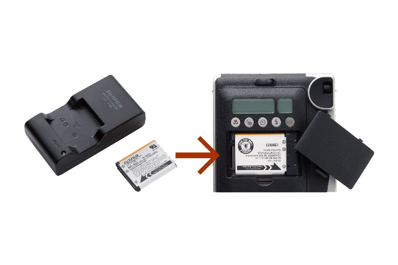 Image of battery charger and battery also battery inserted into the back of Mini 90 battery compartment