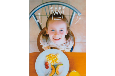 Crown filter picture of child on the chair in front of the table and plate