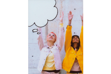 Speech Bubble 3 picture of two girls holding hands up