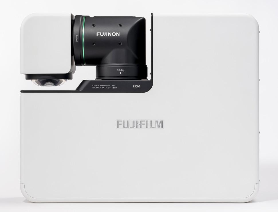 [foto] Parte superior do FP-Z5000 branco em posição compacta, com lente do projetor articulada fechada