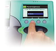 [photo] Finger pressing button on FCR CAPSULA XLII monitor/control panel