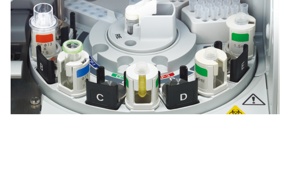 [photo] Rotating tray with various specimens, slides and various on tray inside machine