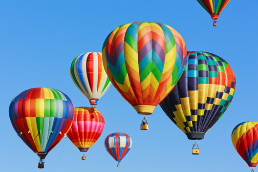 Multiple colorful Hot Air balloons floating in the sky