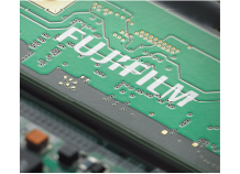 [photo] Close up shot of a circuit board with a Fujifilm print in white