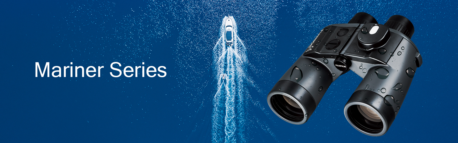 [photo] Black binoculars in front of background of aerial view of white boat cruising through deep blue ocean water