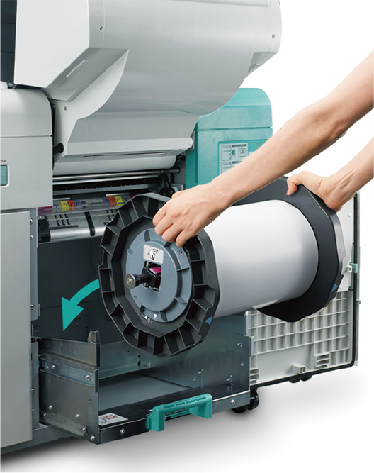 [photo] Woman's arms loading 180mm paper roll into the printer