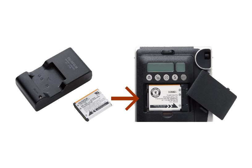 Image du chargeur de batterie et de la batterie, également d'une batterie insérée à l'arrière du compartiment de stockage de la batterie du Mini 90