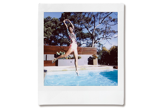 Image of a photo of woman jumping into pool