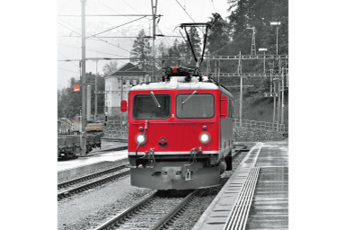 Image of a red train with Red Partial filter applied where everything except the train are black and white