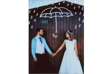 Umbrella filter picture of the young couple in wedding attire