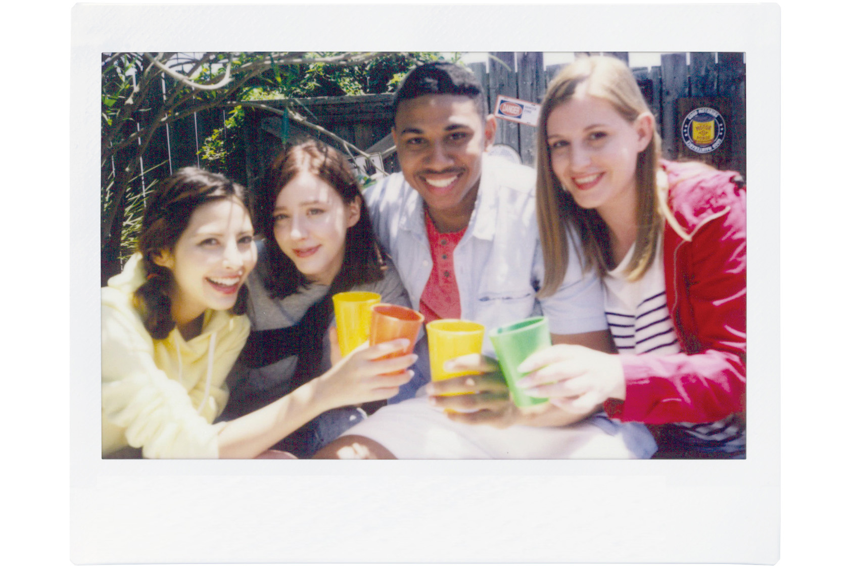 Image of a photo of four friends at outdoor party