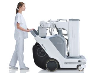 [photo] Healthcare professional pushing FDR Go Plus machine