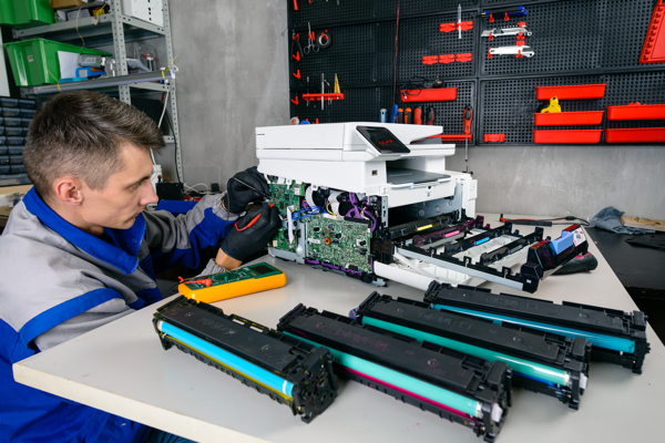 A technician fixing a printer