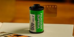 [photo] Fujicolor Superia X-Tra 400 film on a white table book and sample print out