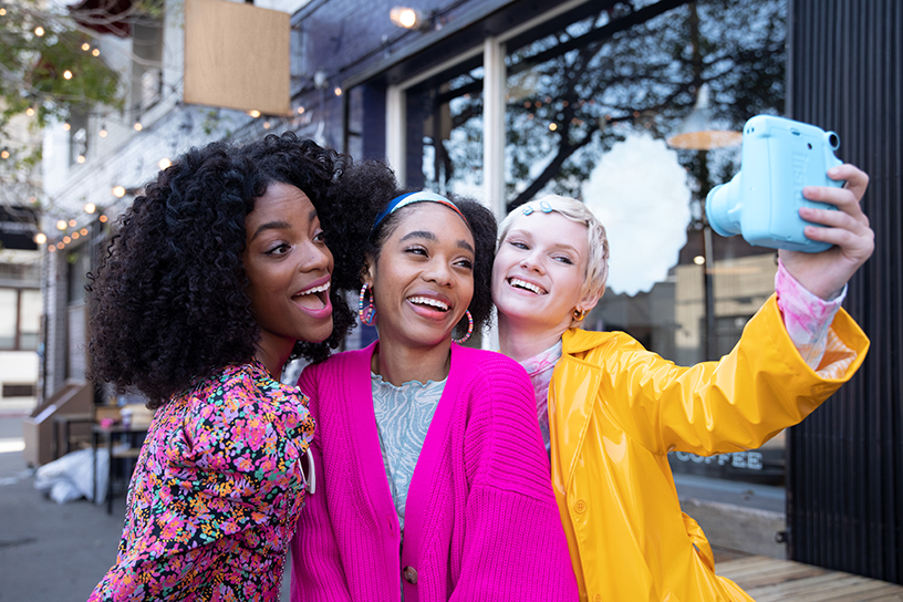 [photo] Three women taking group selfie photo with Sky Blue instax mini 11 camera outside on city street
