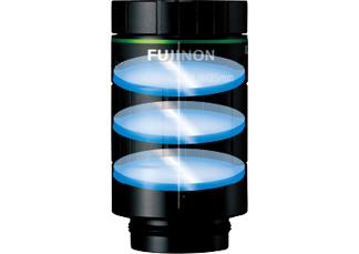 [imagen] Un marco de lente Fujinon con 3elementos de vidrio en capas alineados verticalmente