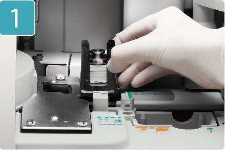 [photo] Gloved hand setting slide inside DRI-CHEM NX500V