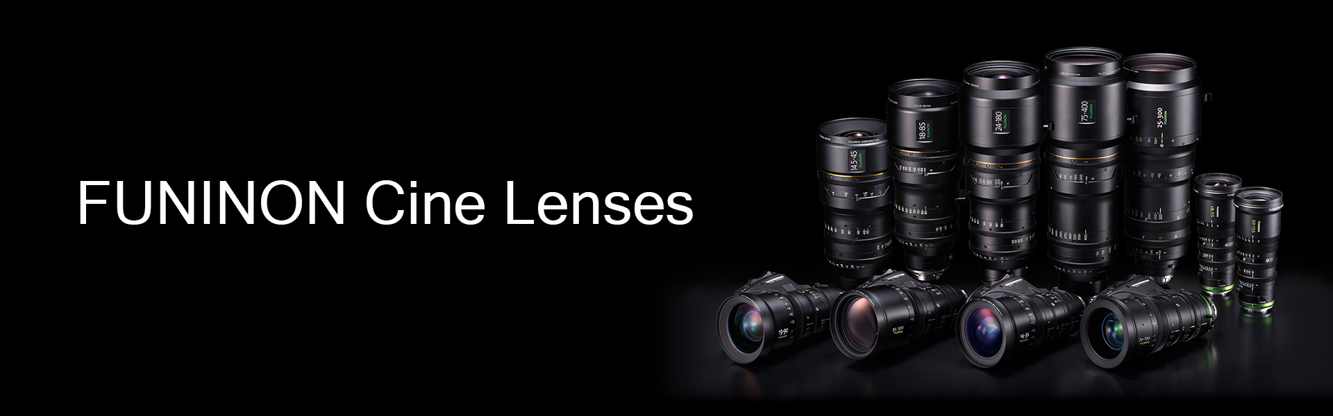 [photo] All the models of Fujinon Cine Lenses stacked upright next to each other in front of black background