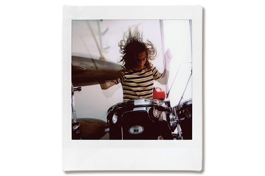 Image of a photo of a man playing drum