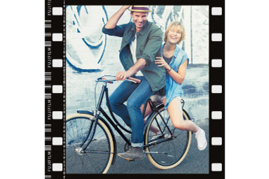 Image of a man and woman on a bicycle with Film Frame filter applied