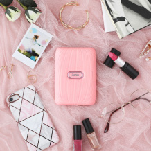 image of pink mini link printer and other items on the table