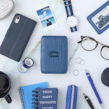 image of blue mini link printer and other items on the table