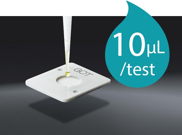 [photo] Dropper applying a drop of fluid onto FUJI DRI-CHEM Slide