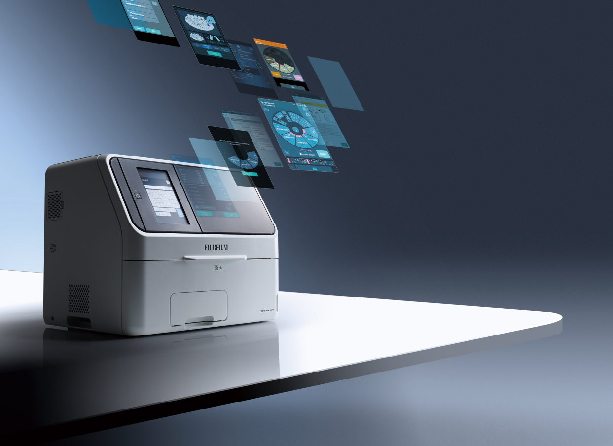 [photo] FUJI DRI-CHEM NX700 with various transparent digital images floating up and away from machine display