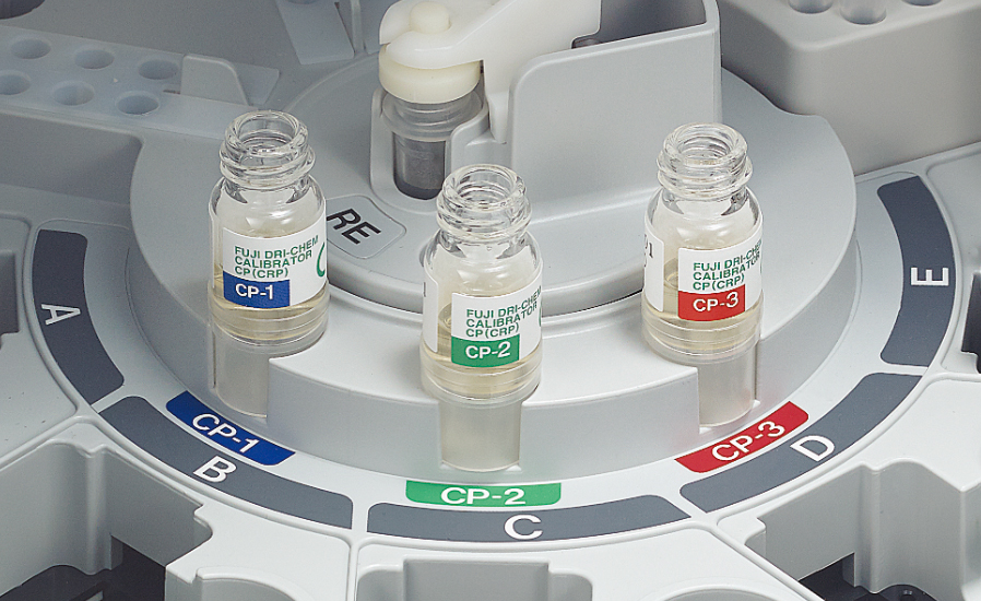 [photo] Tray inside incubator with vials of CP-1, CP-2, and CP-3 calibration fluid on it
