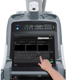 [photo] Hand touching FDR Go PLUS monitor interface and touchscreen