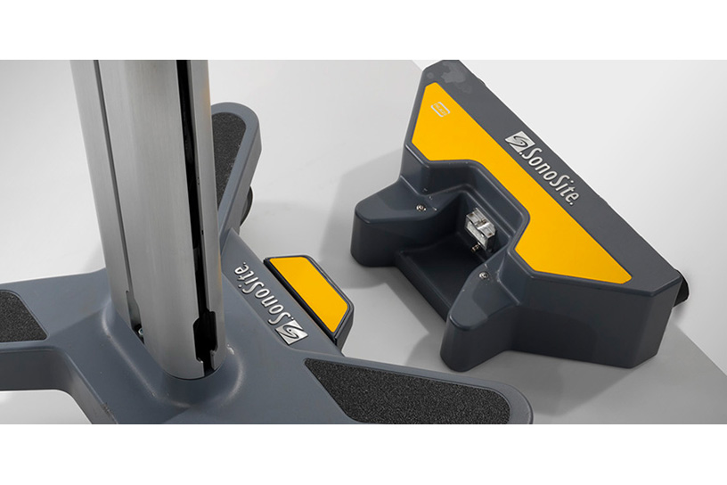 [photo] Yellow and black PowerPark attachment at base of stand next to wheels