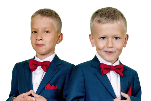 Two children wearing tuxedos with red bow-ties