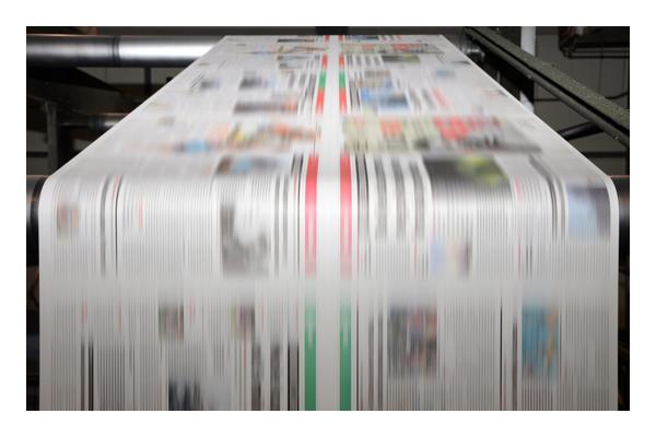 [foto] Impresión en un papel en curso en una máquina de impresión