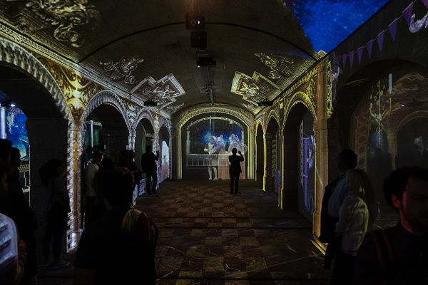 [photo] Lights projected unto the ceiling, walls, and pillars of cathedral-style room