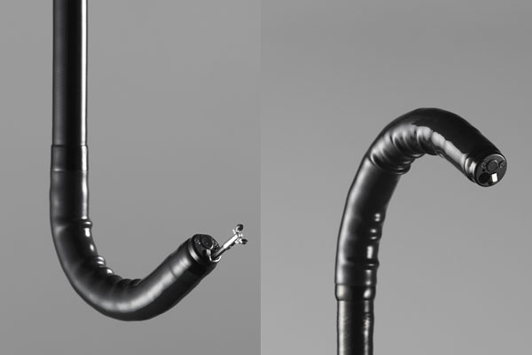 [photo] Endoscope tip flexed in upwardly bent position and endoscope tip flexed in downward bent position