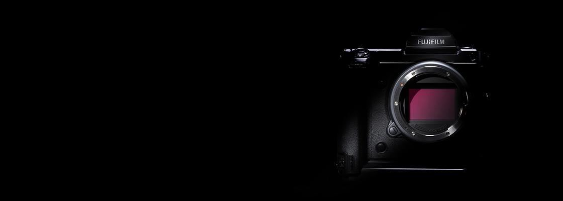[photo] Front view of a Fujifilm GFX without a lens on a black background