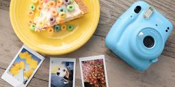 [photo] Fujifilm Instax Mini 11in blue with sample prints and breakfast on a wooden table