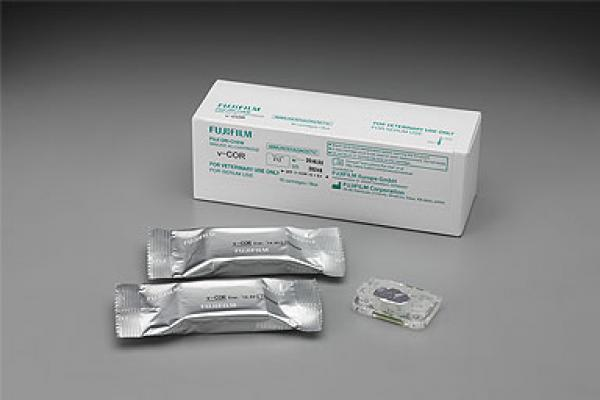 [photo] A pack of v-COR (Cortisol) with some slides on a table