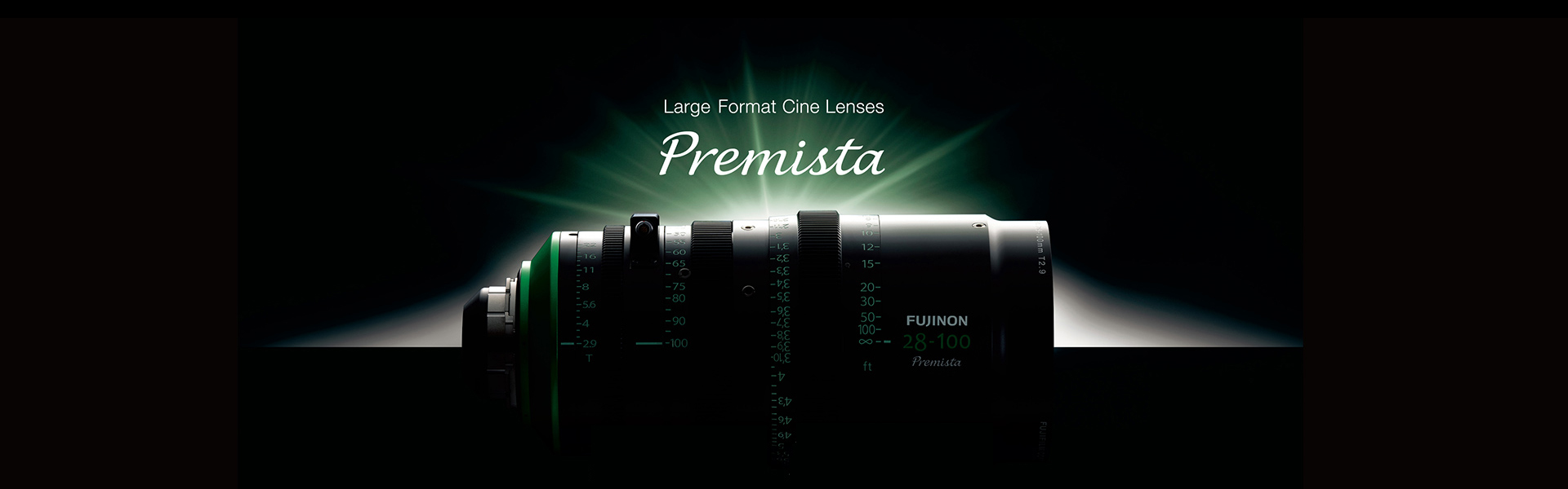 [photo] Fujinon 28-100 Premista Large Format Cine Lens full-width view on its side with green light shining upon it