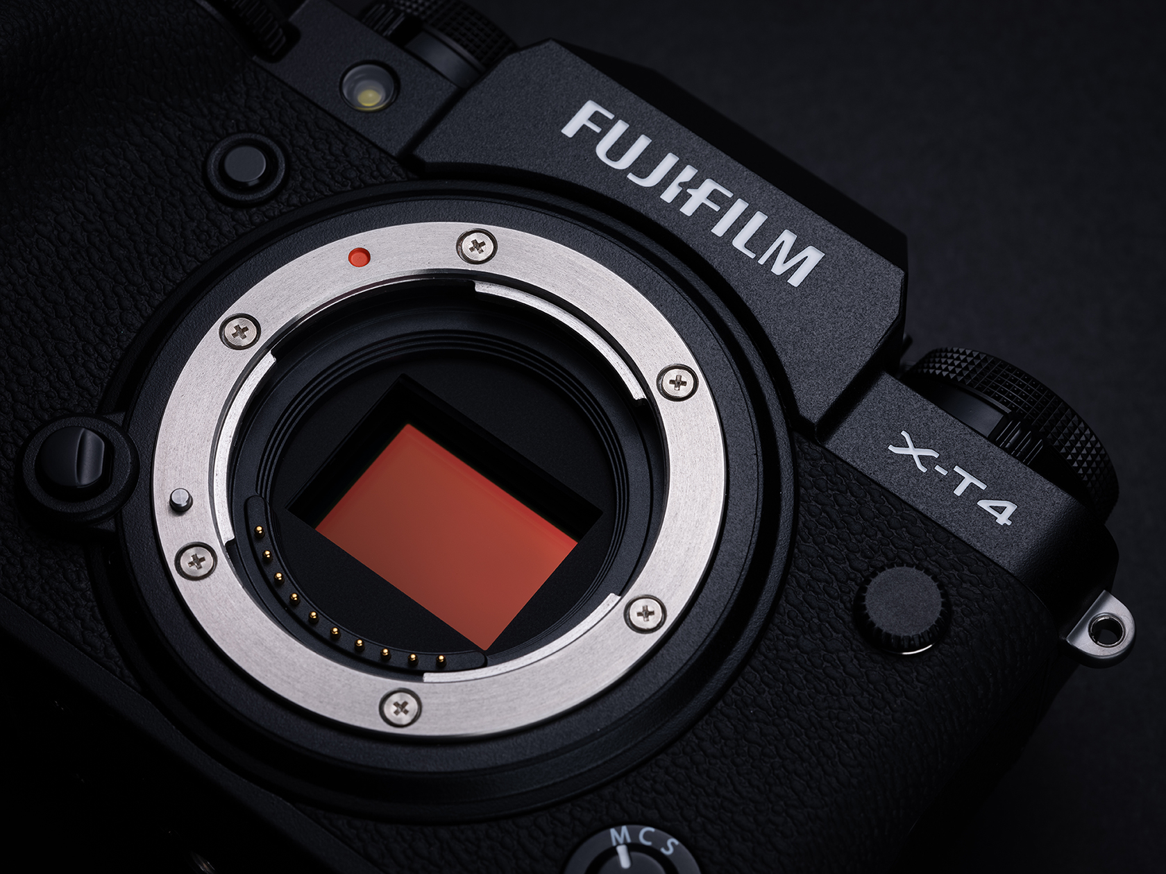 [photo] Top view of a Fujifilm X-T4 System Digtial Camera Body - silver and black