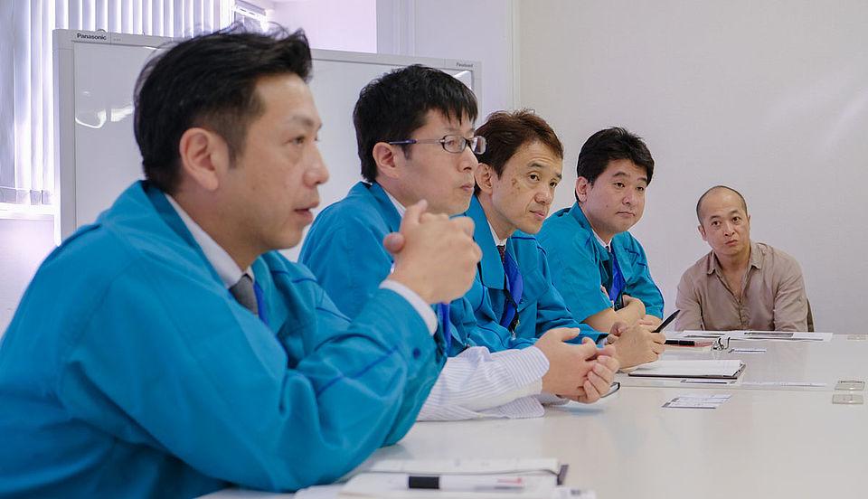 [photo] From left: Onoki (Product planner), Takeda (Mechanical designer), Toyama (optical designer), Sasaki (Optical engineer), Sakai (Designer) during a Fujifilm presentation