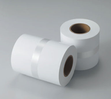 [photo] Two blank rolls of paper next to each other, one standing upright and other on its side