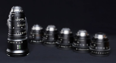 [photo] An tall ZX series lens with a collection of shorter ZK series lenses as a blurry background