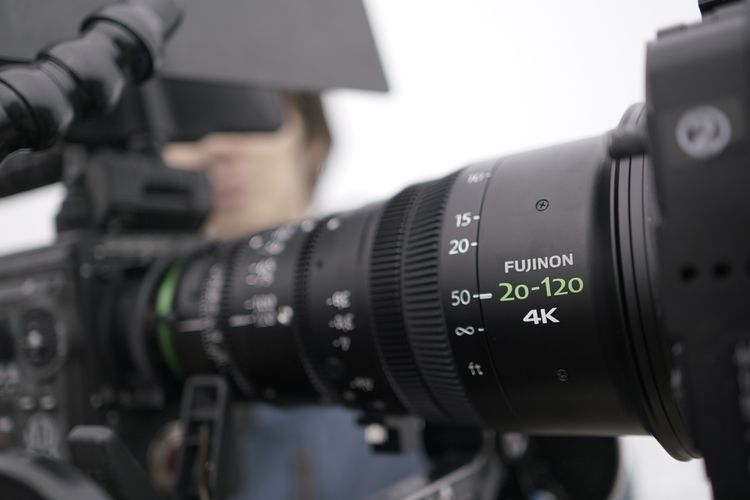 [photo] A front sideview of a Fujinon XK Series lens with the etched logo in focus