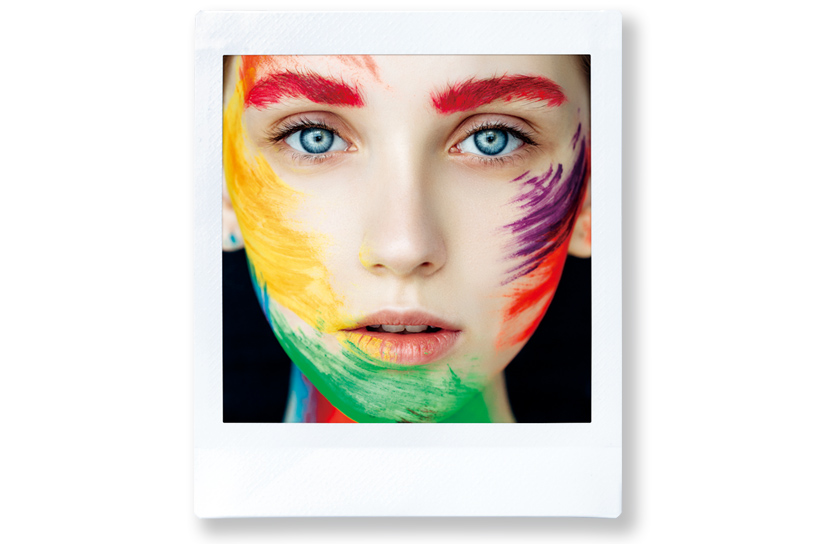 [photo] A portrait of a girl's face painted in different colors with the standard Instax frame